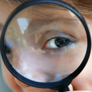 Child looking through magnifying glass