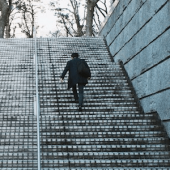 Man walking up steps